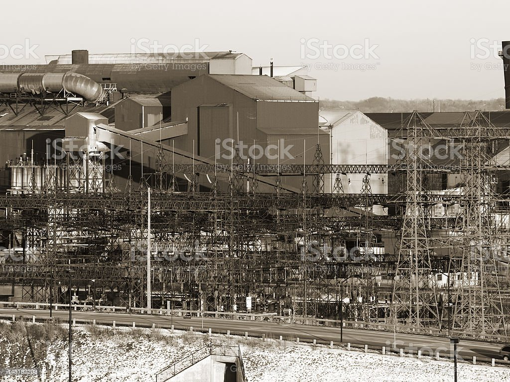 Steel mill in sepia royalty-free stock photo