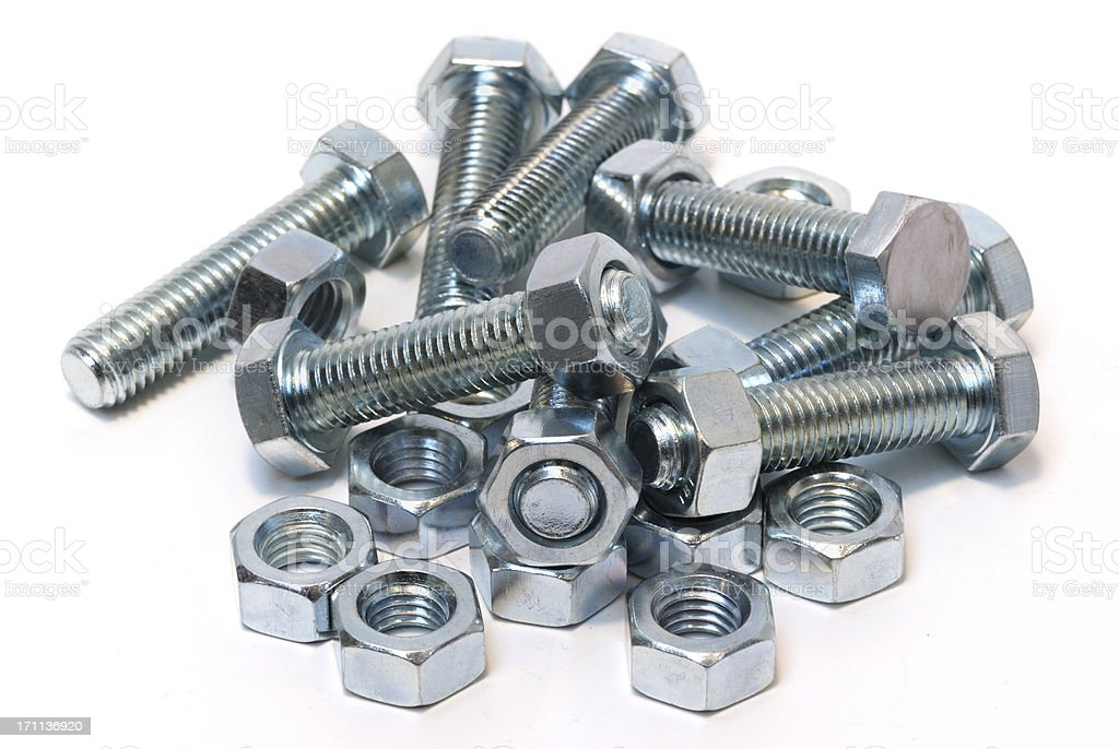 Steel nuts and bolts isolated on white royalty-free stock photo