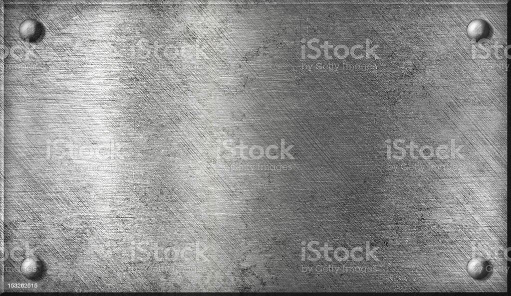 steel or aluminum metal plate with rivets stock photo