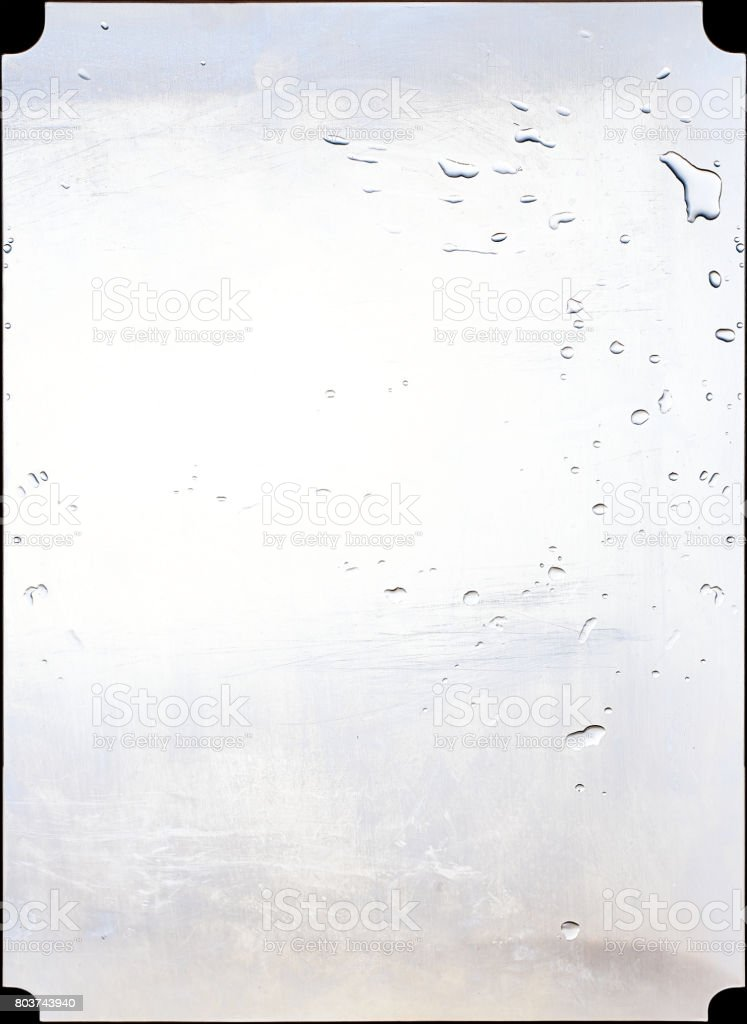 Steel panel of a kitchen splashed with water. stock photo