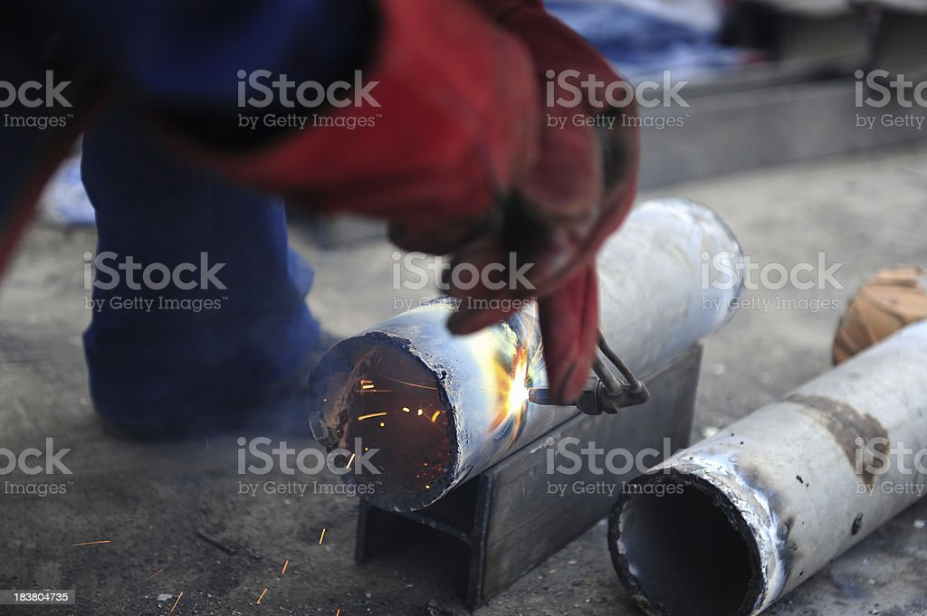 Steel Pipe Cutting-Oxygen Fire Slicing Tubes With Sparks stock photo