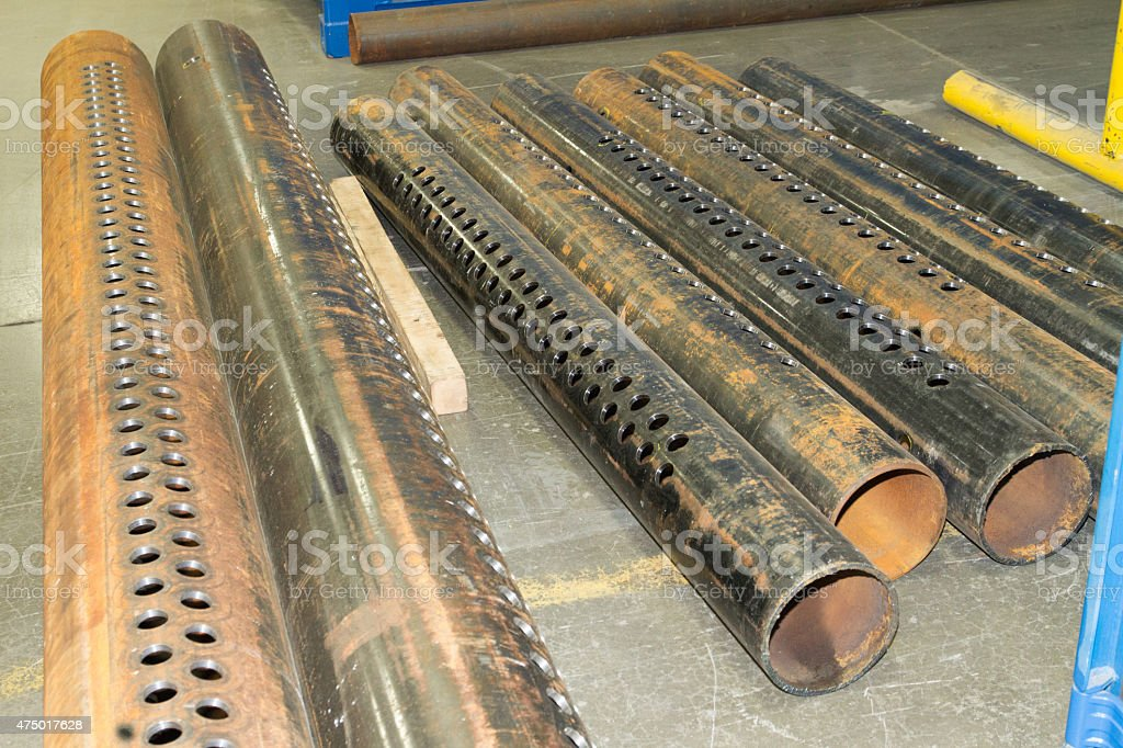 Steel pipe machined with holes stock photo
