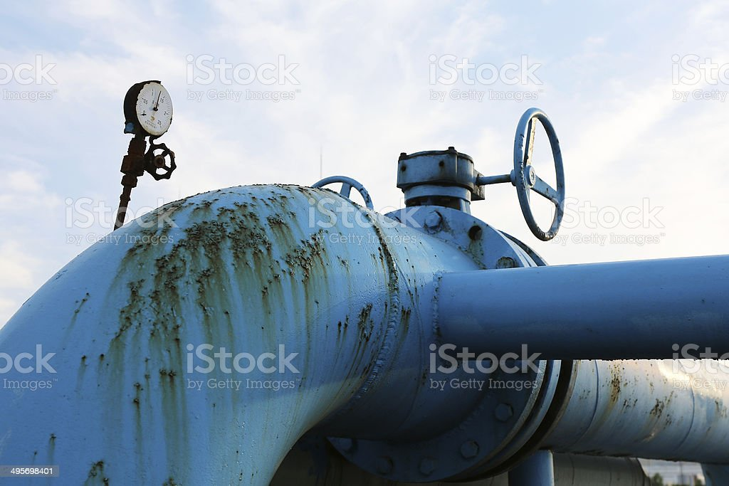 Steel pipelines and valves against blue sky royalty-free stock photo