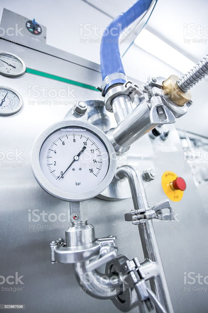 Steel pipelines and valves on trucks transport milk at factory stock photo