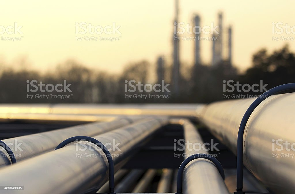 steel pipes in crude oil factory stock photo