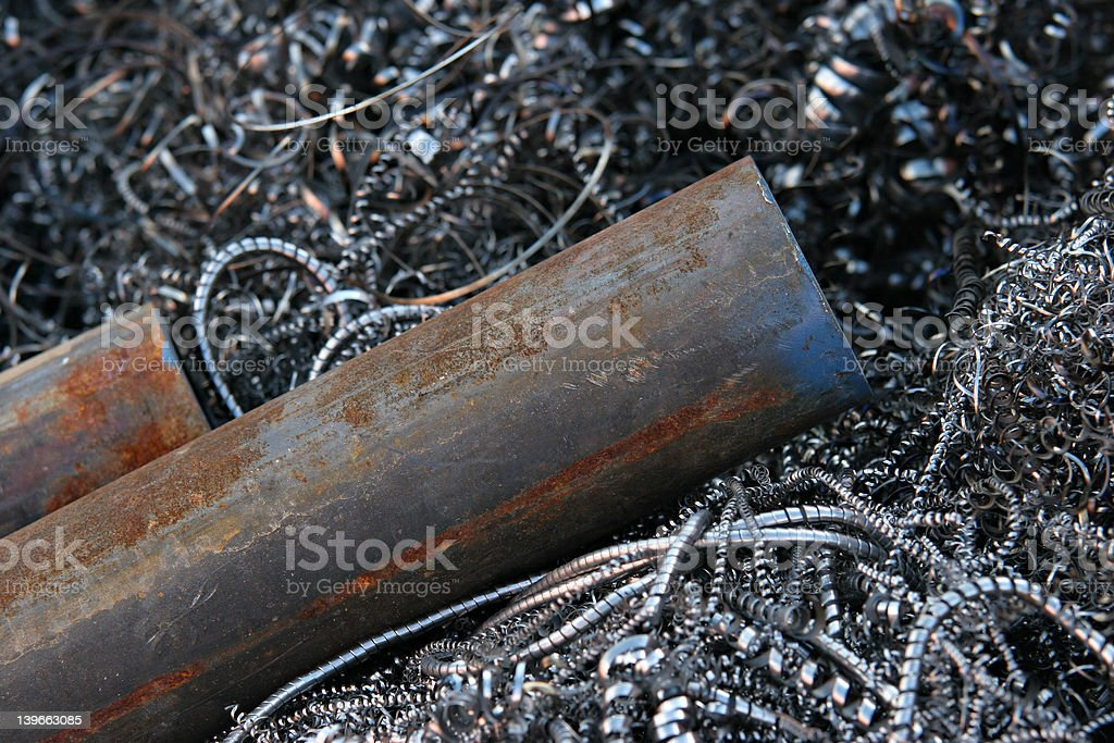 steel pipes on shavings royalty-free stock photo