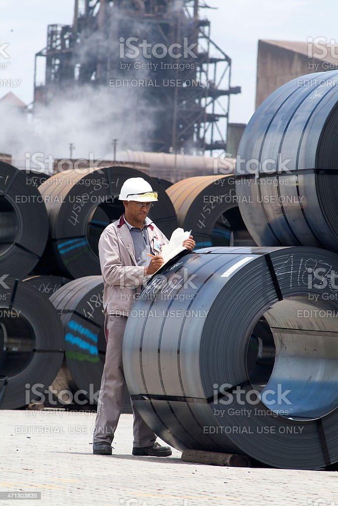 Steel plant worker checks stock stock photo