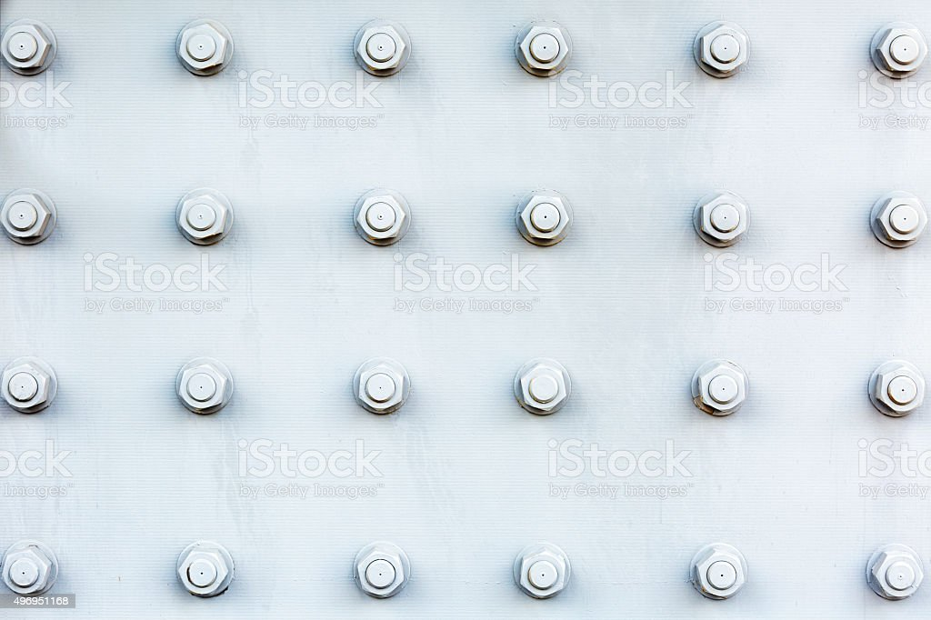 Steel plate background with bolts and nuts, copy space stock photo
