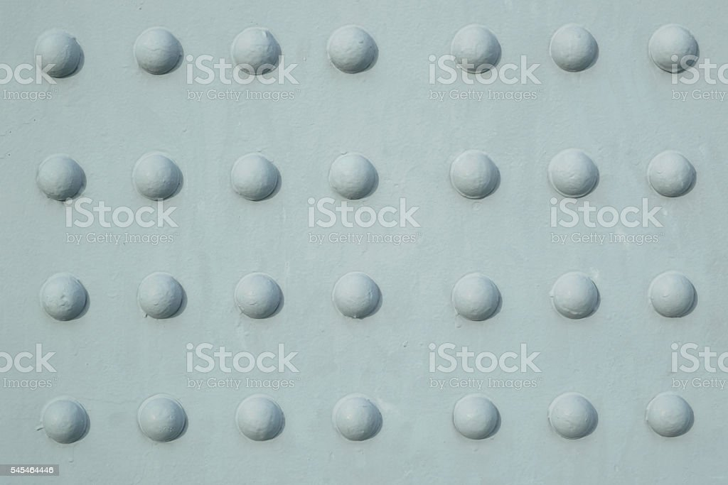 Steel plate with circular buttons Rustproof coating well. stock photo