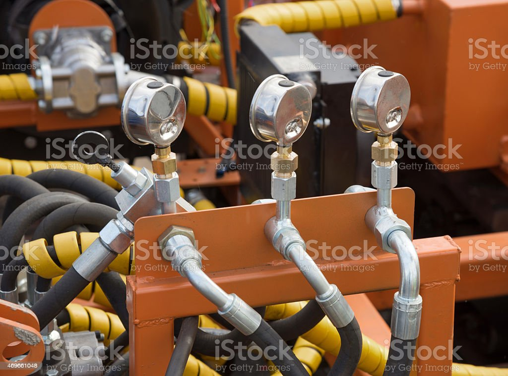 Steel plates with hydraulic tubes and fittings stock photo
