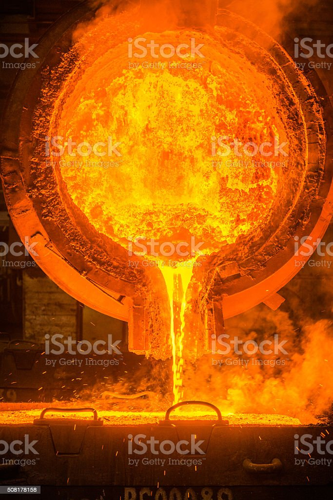 steel pouring stock photo