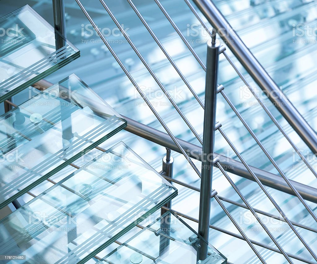 Steel railings and stairs made of glass stock photo