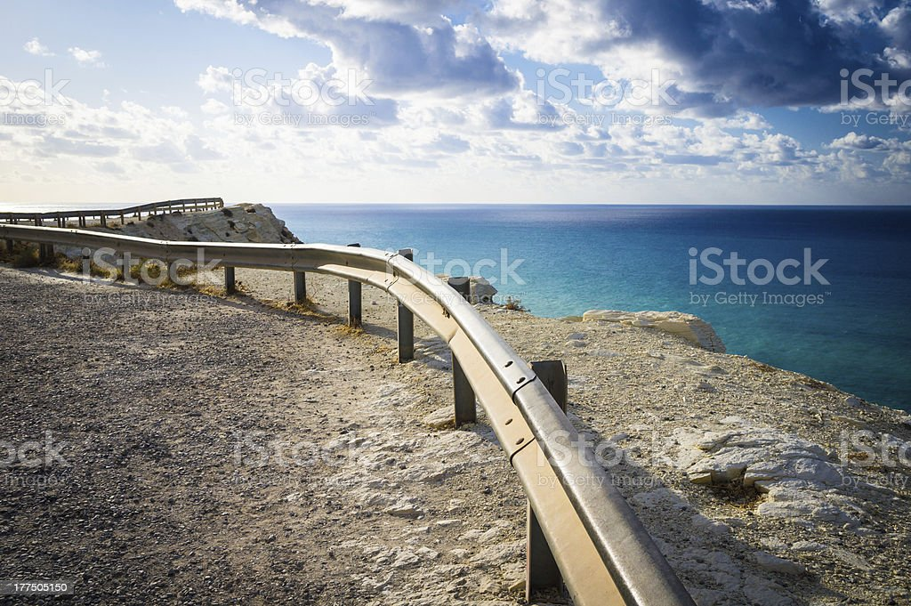 Steel road barrier on a sea cliff stock photo