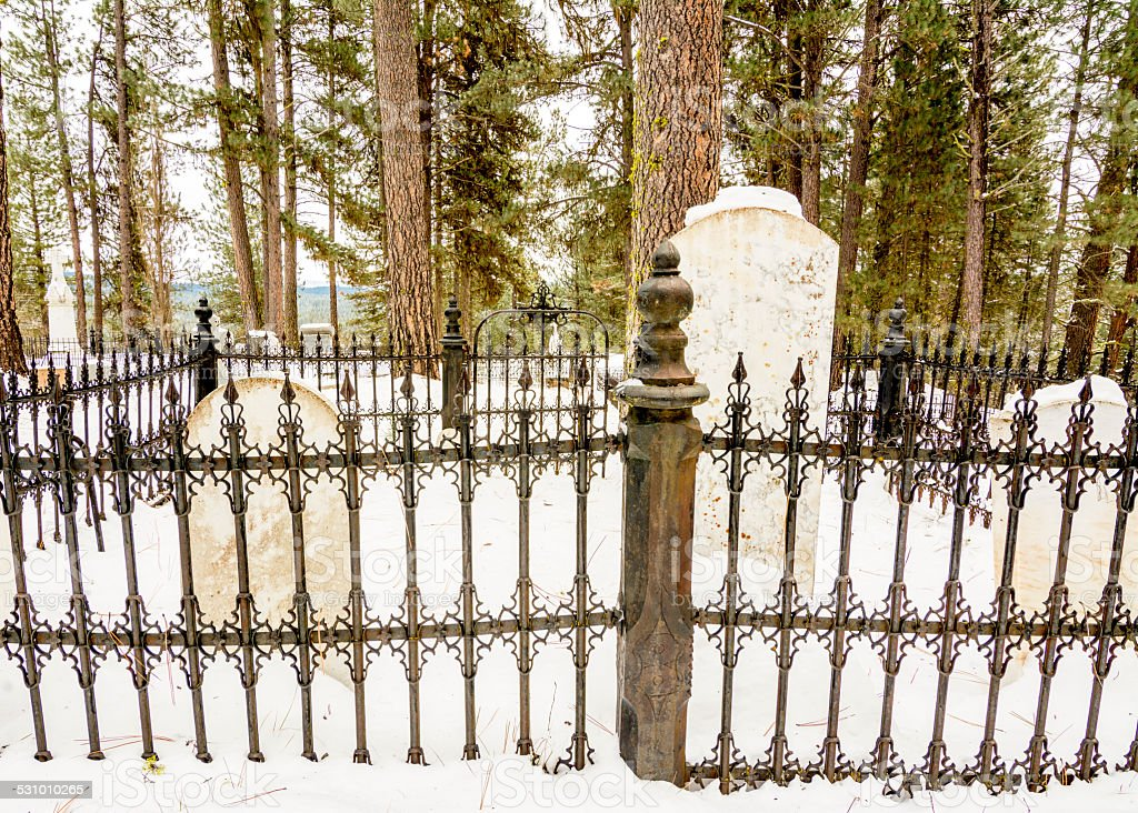 Steel rod fence in a mountain cemetery stock photo