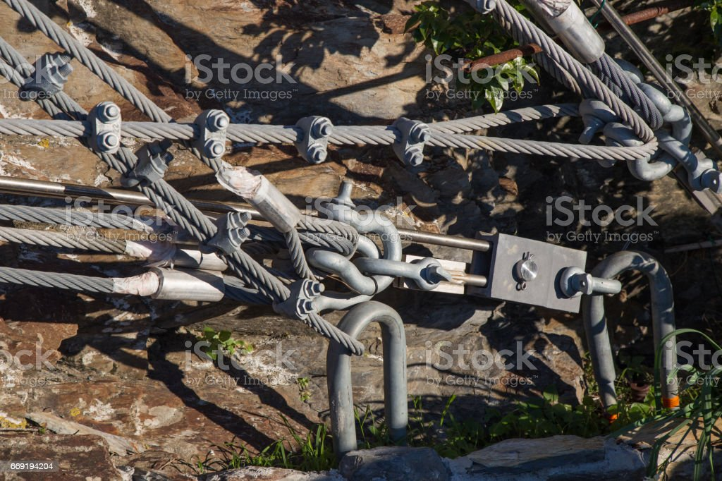 Steel rods anchored to the rock.In the Cinque Terre area. stock photo