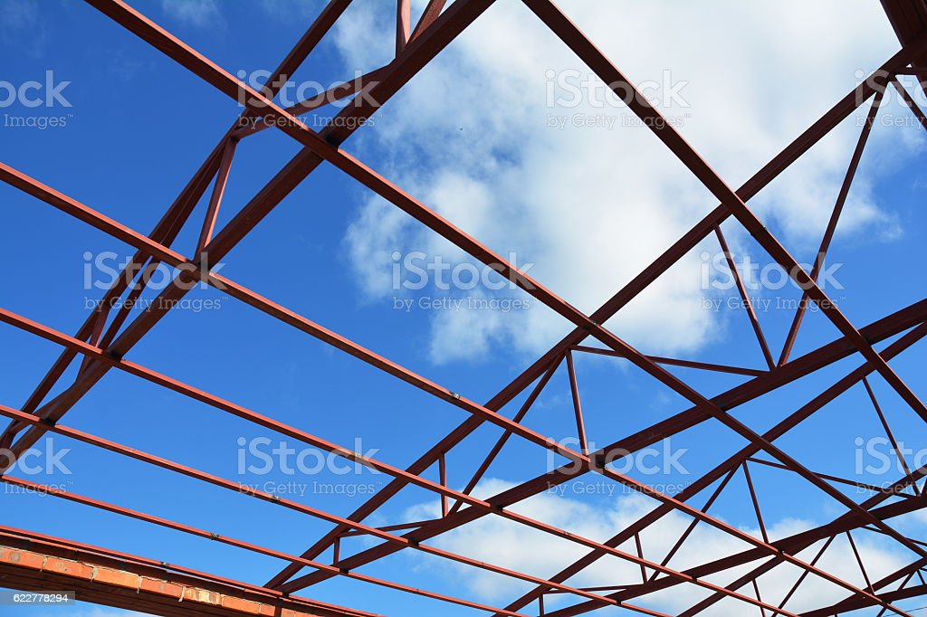 Steel roof trusses details with clouds sky background stock photo