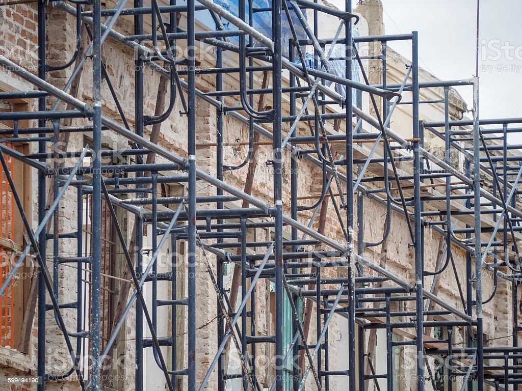 Steel scaffolding for restoration of building stock photo