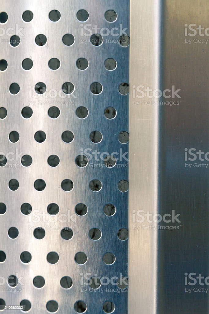 Steel sheet perforated with smooth suface stock photo