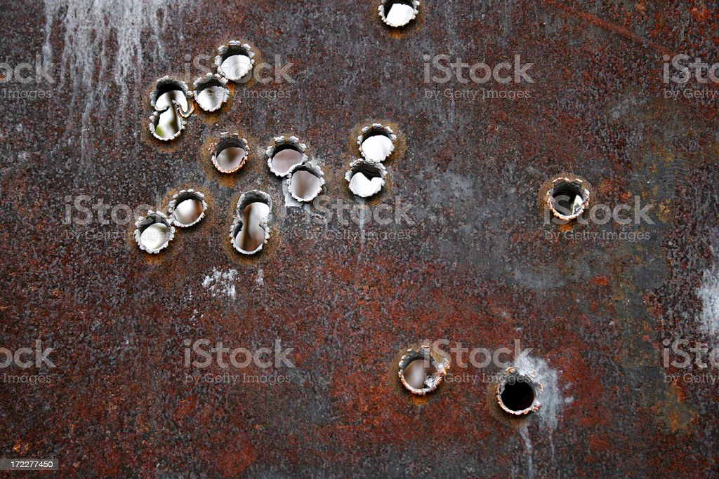 Steel sheet used for target practice bullet holes stock photo