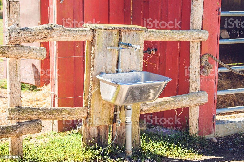Steel sink outside a barn stock photo