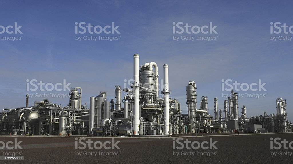 Steel storage structures and smoke stacks of a fuel refinery royalty-free stock photo