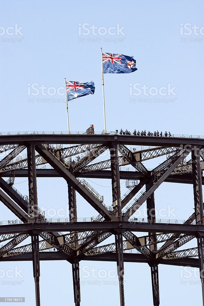Steel structure of bridge with tourists and two Australian flags stock photo
