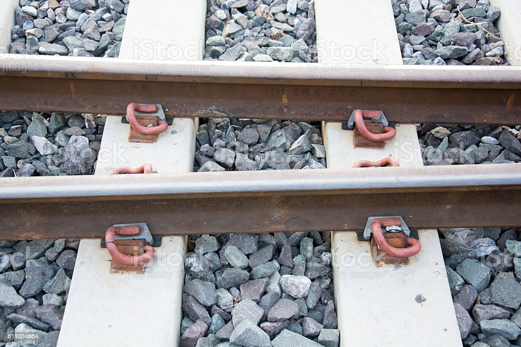 Steel support rails with concrete sleepers strewn with gravel stock photo