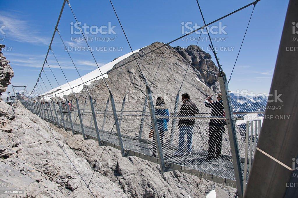 Steel suspension bridge on top of Titlis in Engelberg, Switzerland stock photo