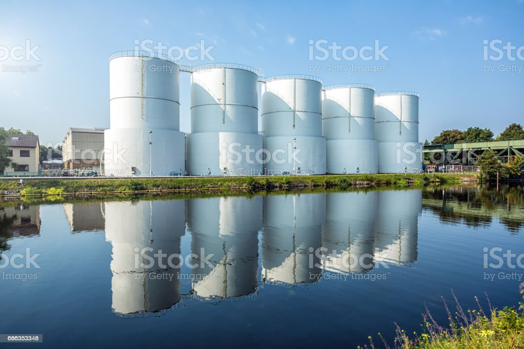 Steel Vessels close to the river stock photo