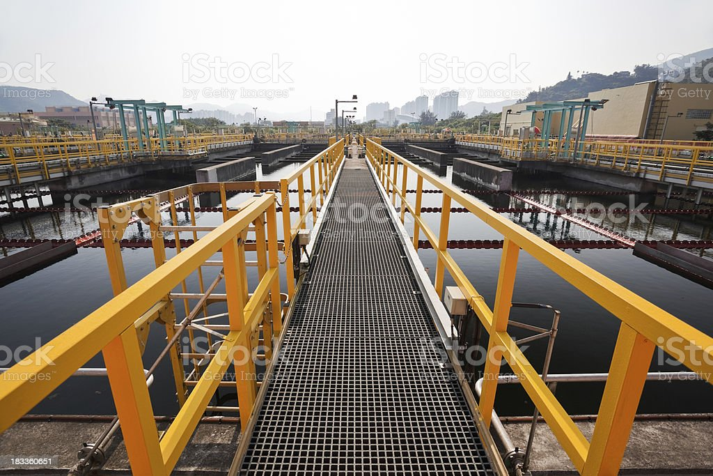 Steel walkway in a sewage treatment plant stock photo