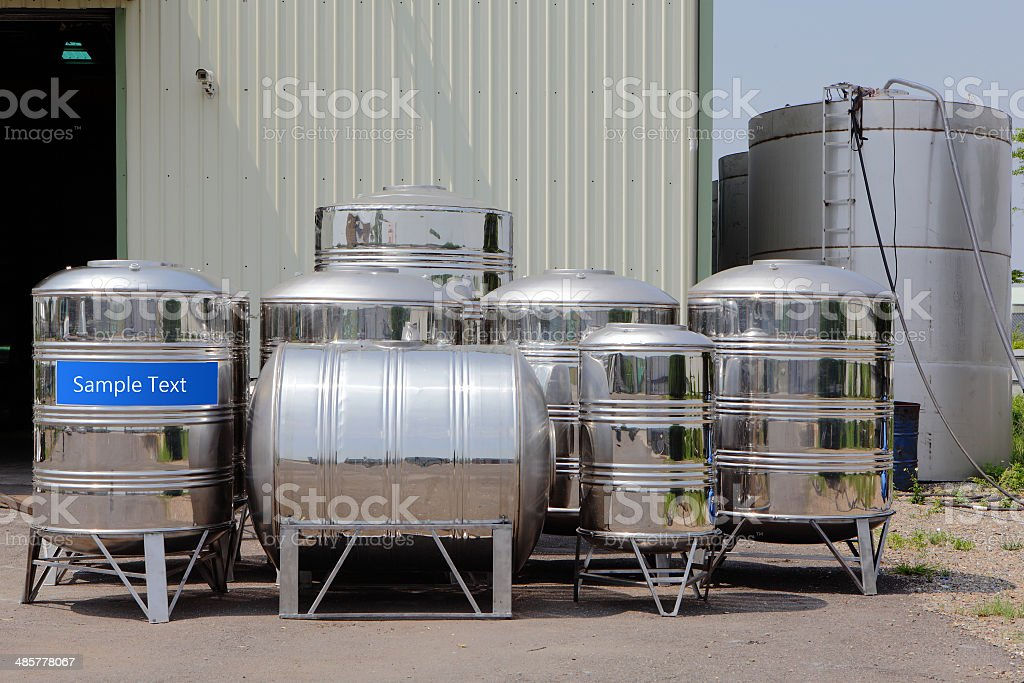 steel water tower tank with sample text stock photo