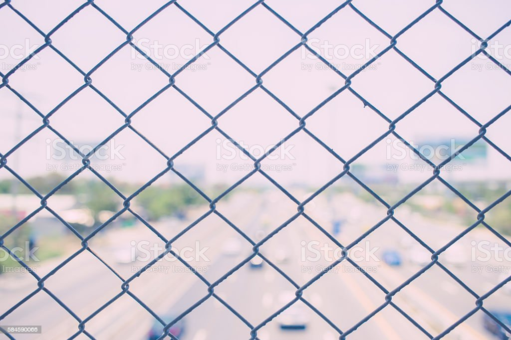 steel wire mesh with city road highway.  vintage photo stock photo