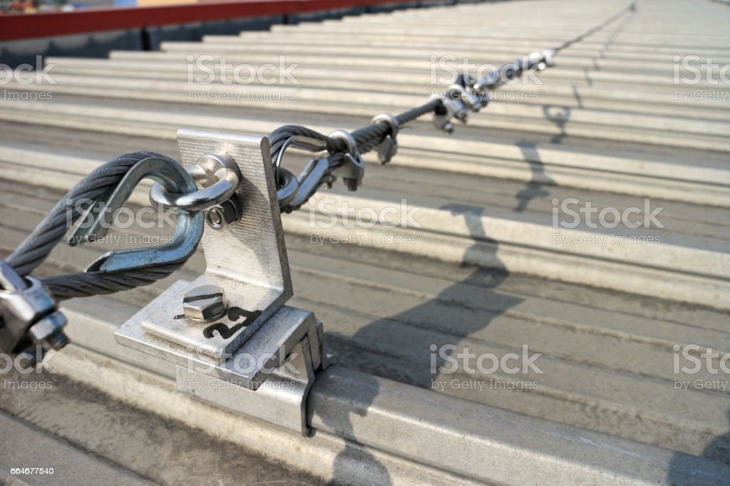 Steel Wire Rope Lifeline on Roof stock photo