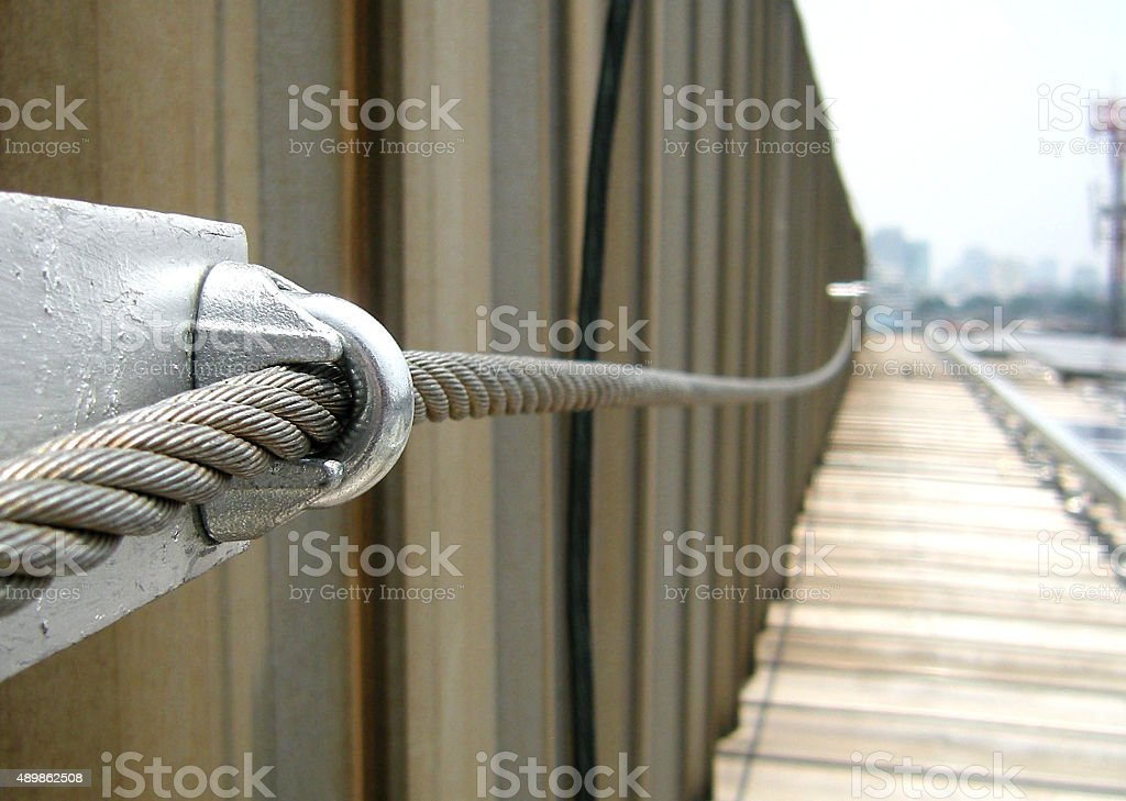 Steel Wire Rope Sling Lifeline on Factory roof stock photo