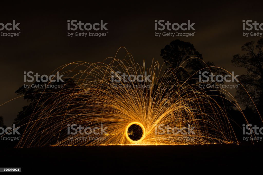Steel wool photography taken in front of forest stock photo