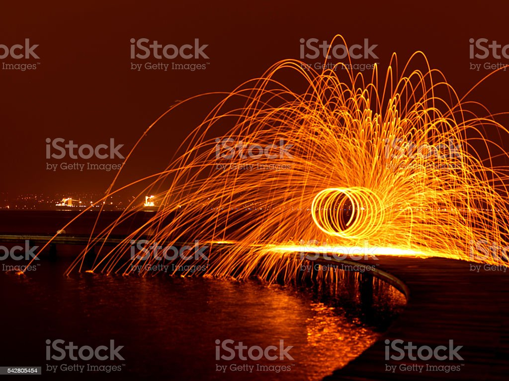 Steel Wool spinning at the beach stock photo