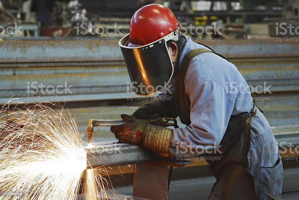 Steel Worker cutting with blow torch stock photo