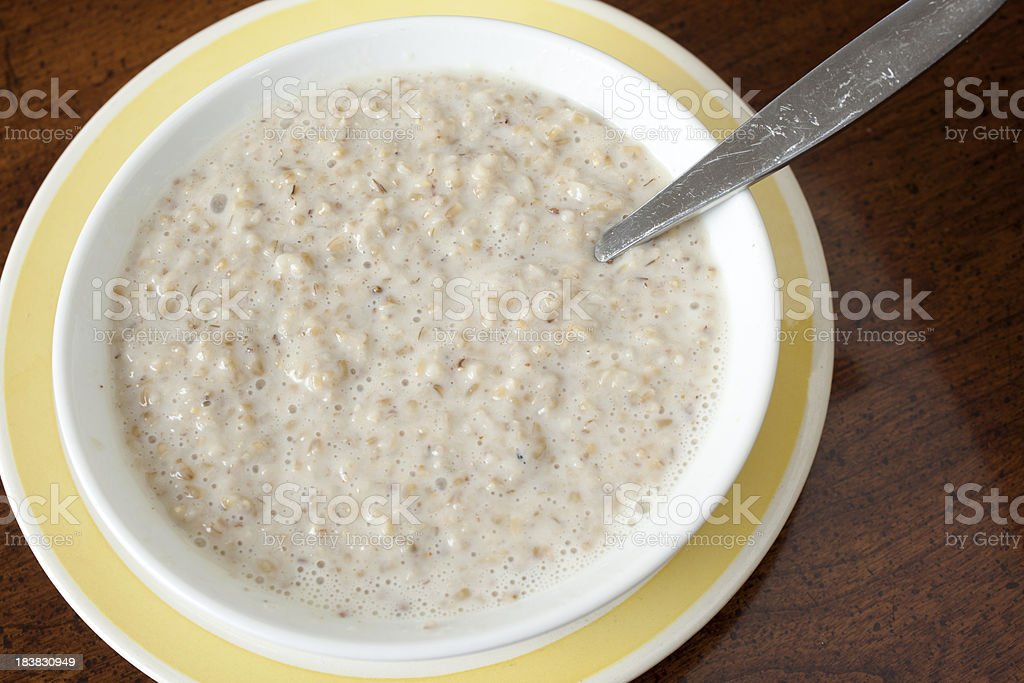 Steel-cut Oatmeal in Bowl royalty-free stock photo