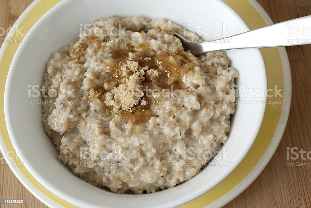 Steel-cut Oatmeal in Bowl with Brown Sugar royalty-free stock photo