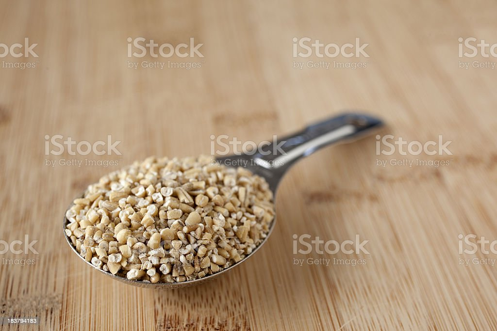 Steel-cut Oats in a Tablespoon stock photo