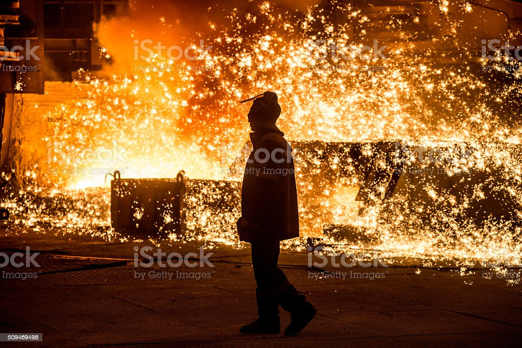Steelworker near a blast furnace with sparks stock photo