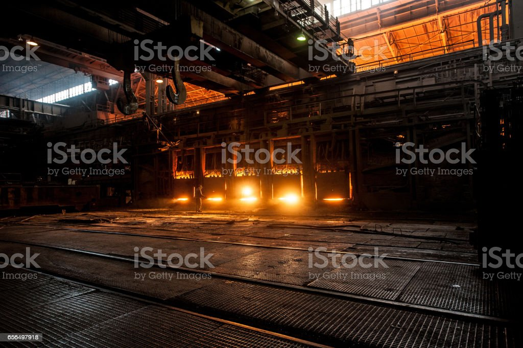 Steelworker near the working open hearth furnace stock photo
