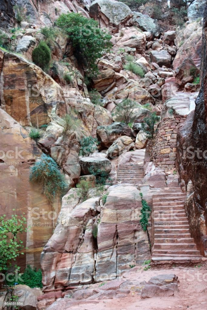 Steep ascent to High sacrificial place in nabatean city of Petra, Jordan Middle East stock photo