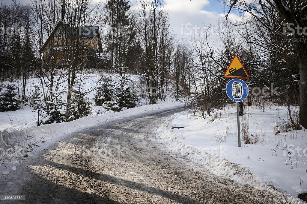 Steep driveway and obligatory using of wheel chains road sign royalty-free stock photo