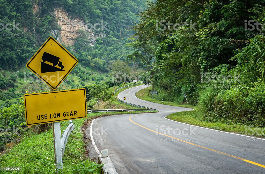 Steep Hill Descent Traffic Sign on the Road stock photo