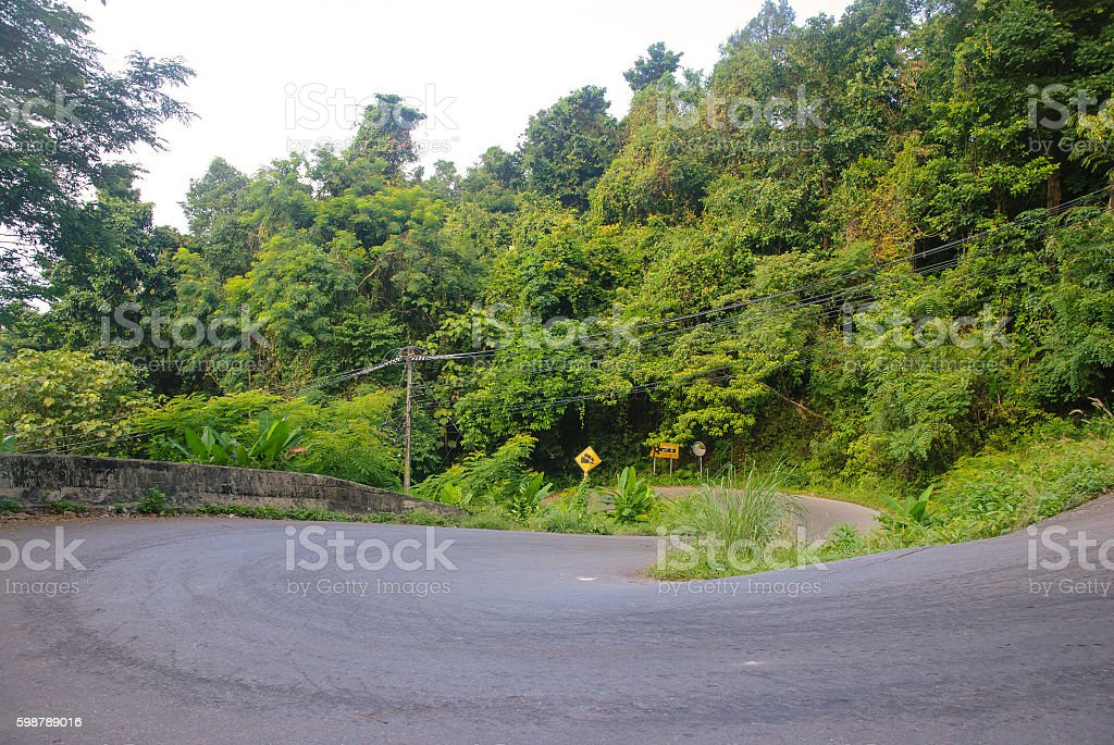 steep mountain road in the jungle on Ko Chang, Thailand stock photo