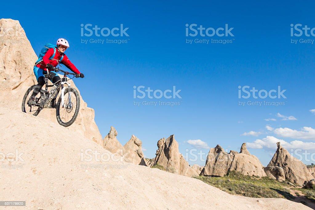 Steep mountainbike downhill on white tuff formations, Cappadocia, Turkey stock photo