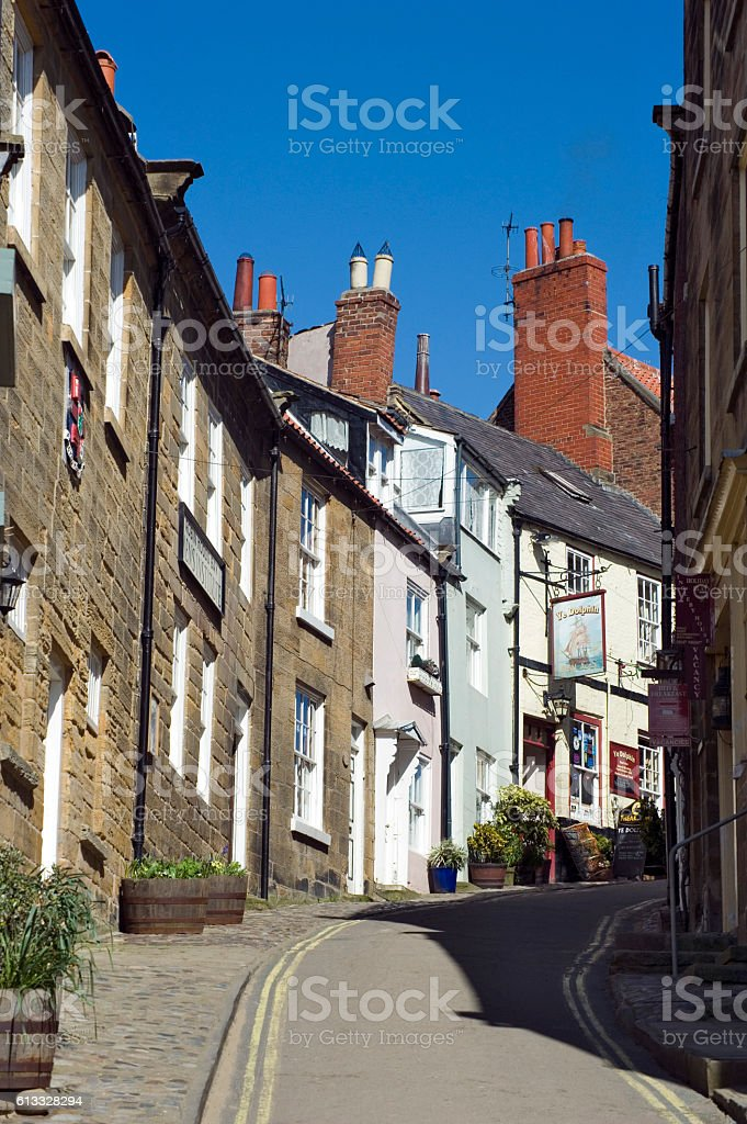 Steep narrow street with houses on either side stock photo