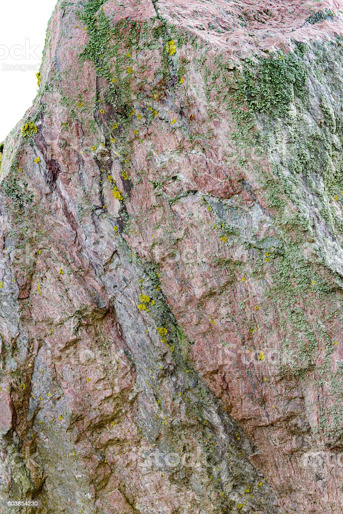 Steep Rugged Rock-Face Wall Cliff Moss, Red Brown Background White stock photo