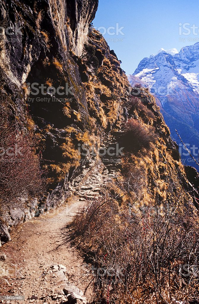 Steep steps on a cliff edge with beautiful view royalty-free stock photo